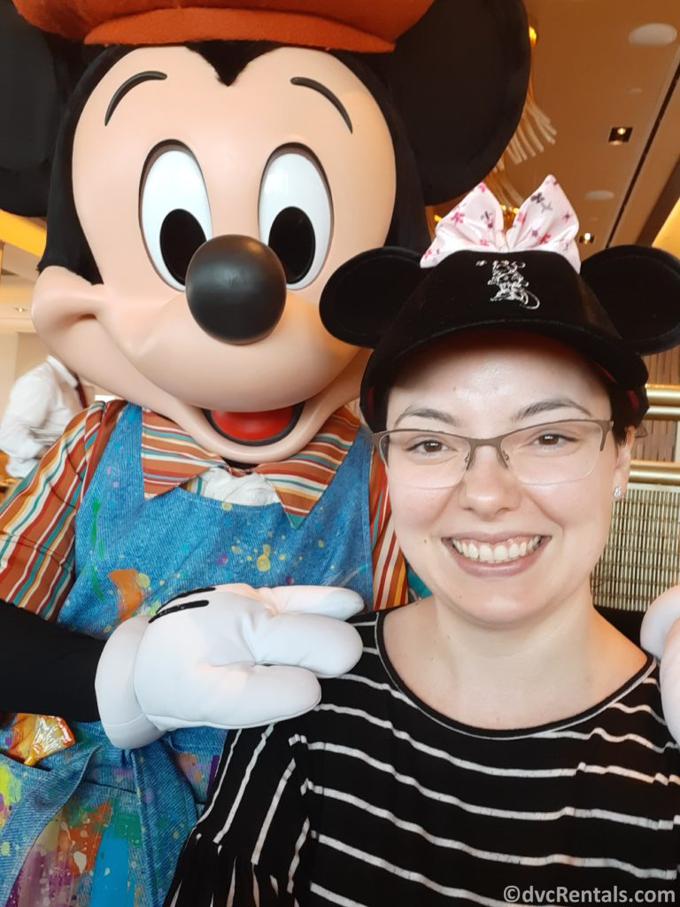 Team Member Deandra with Mickey Mouse