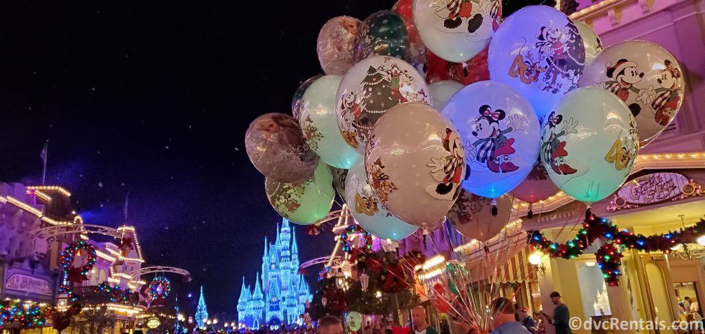 Balloons, Christmas Decorations and Cinderella Castle at the Magic Kingdom