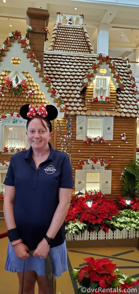 Team member Kelly in front of the Gingerbread house at Disney's Grand Floridian