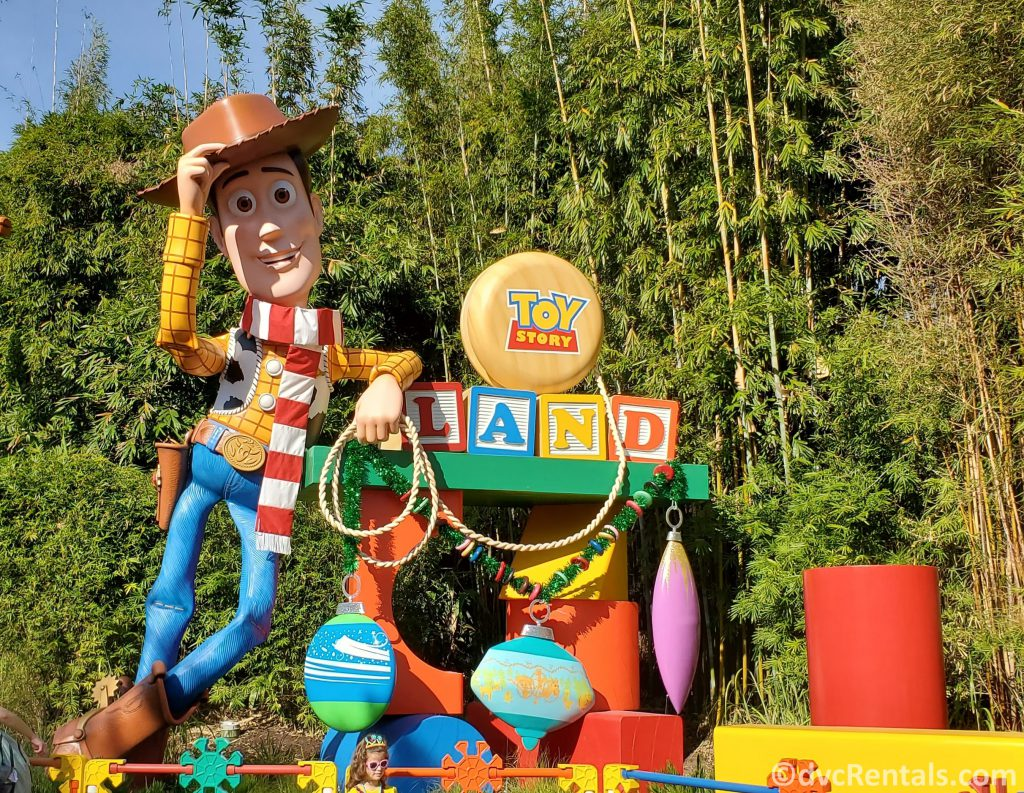 Toy Story Land Sign with Woody wearing a Christmas scarf