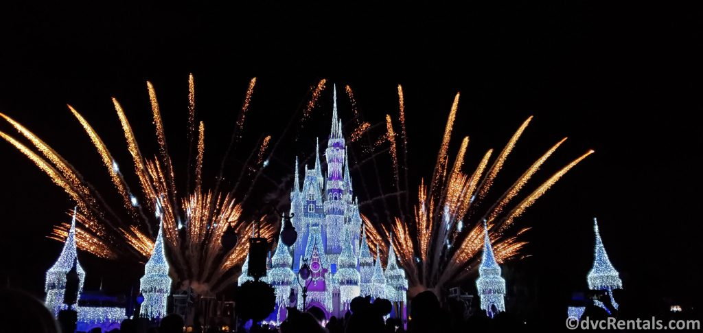 Cinderella Castle with Christmas Lights on and Fireworks in the background