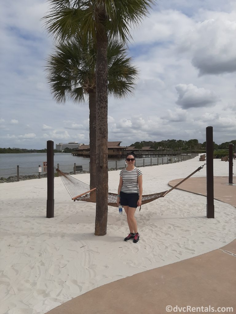 Team Member Deandra on the beach at Disney's Polynesian Villas & Bungalows