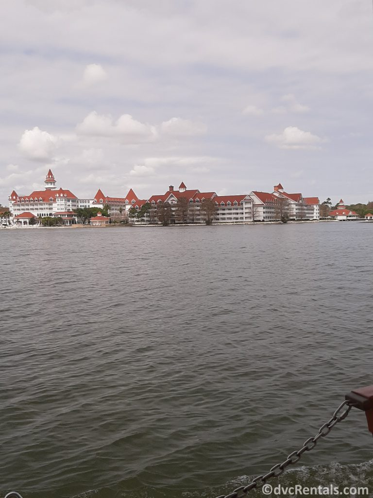 View of the Villas at Disney's Grand Floridian from a boat on the Seven Seas Lagoon