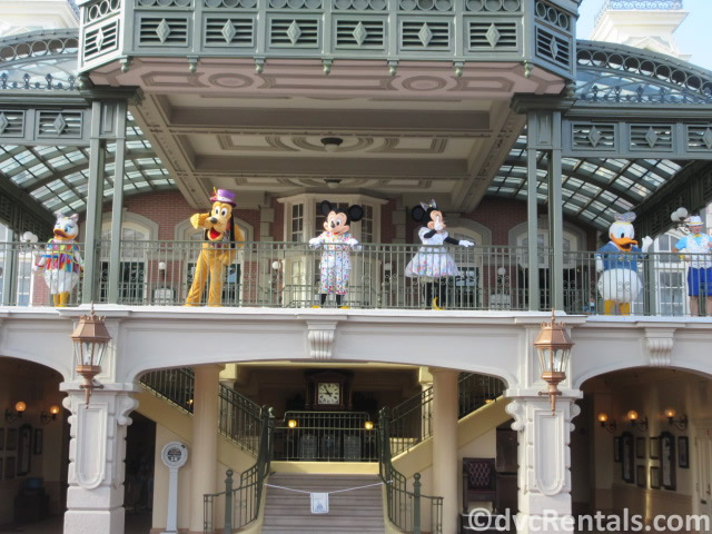 Disney characters waving from the Train Station