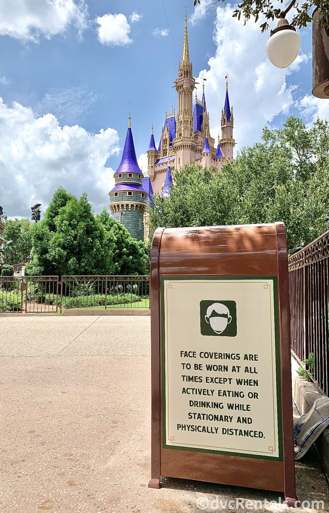 Social Distancing sign with Cinderella Castle in the background