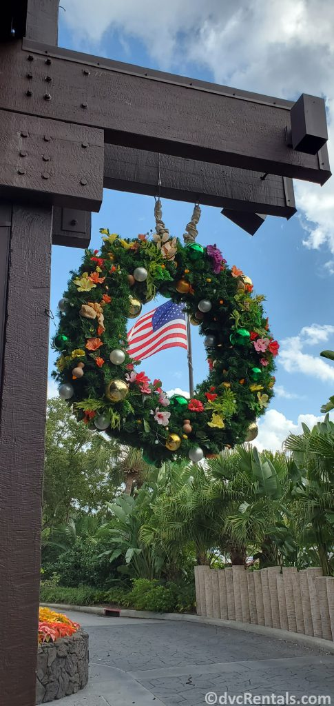 Christmas wreath with American Flag waving in the background