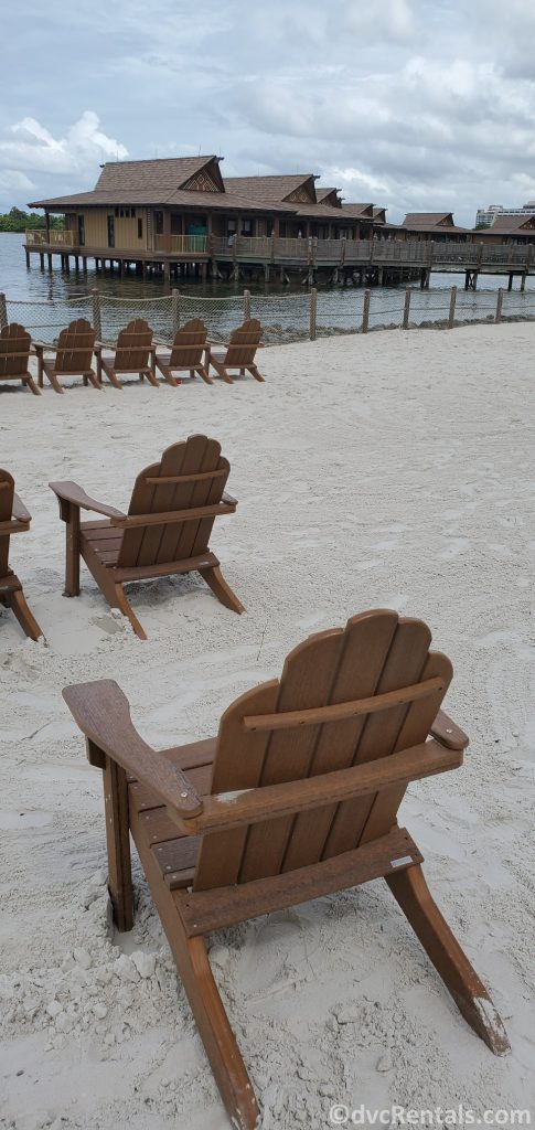 lounge chairs at the beach of Disney's Polynesian Villas & Bungalows