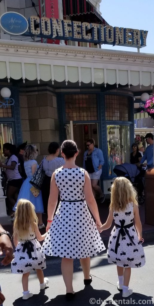 family Dineybounding at the Magic Kingdom as Cruella DeVil and dalmatians