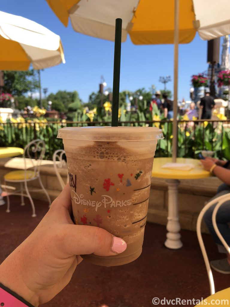 Iced-coffee with Cinderella Castle in the background