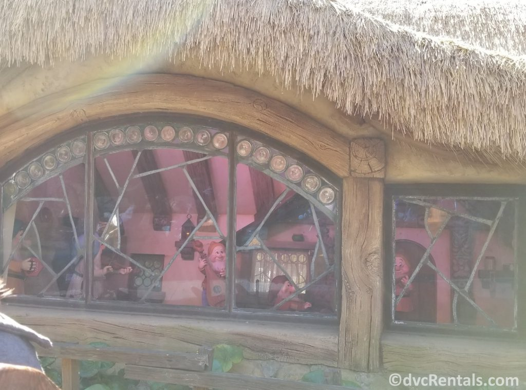 Seven Dwarfs and Snow white in the cottage as part of the Seven Dwarfs Mine Train at Magic Kingdom