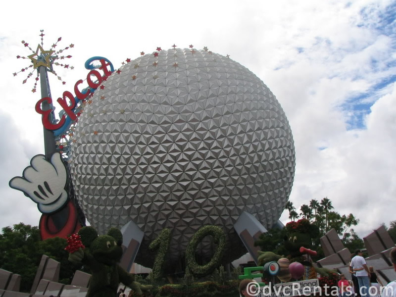 Epcot Geosphere with the wand and Epcot sign