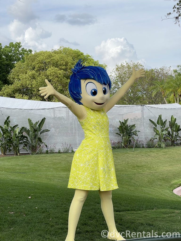 Joy from Inside Out waving to guests at Epcot