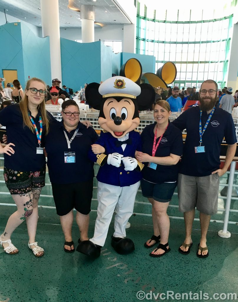 Team Members Chelsey, Lindsay, Stacy, and Kevin with Mickey Mouse at the Port Canaveral cruise terminal