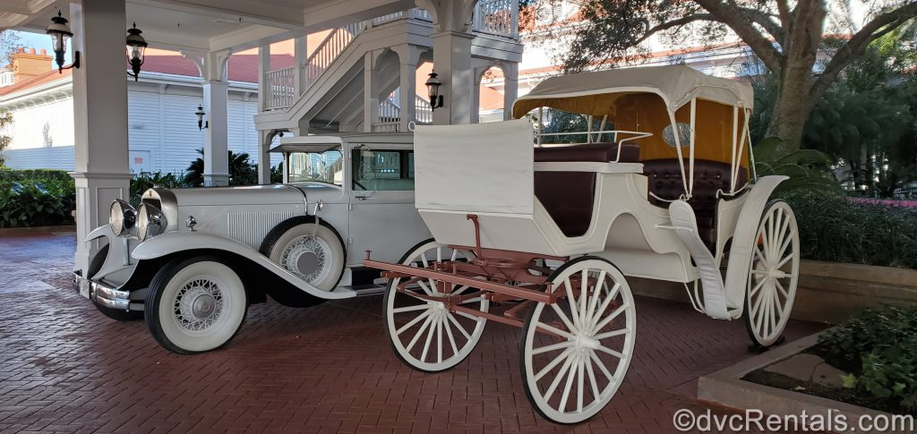 Classic car and carriage in front of the Grand Floridian Resort and Spa