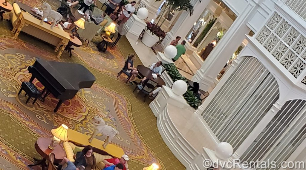 Grand piano and birdcage elevator in the lobby of Disney's Grand Floridian
