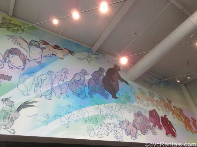 sketches of Disney characters on the walls a the Animation Experience