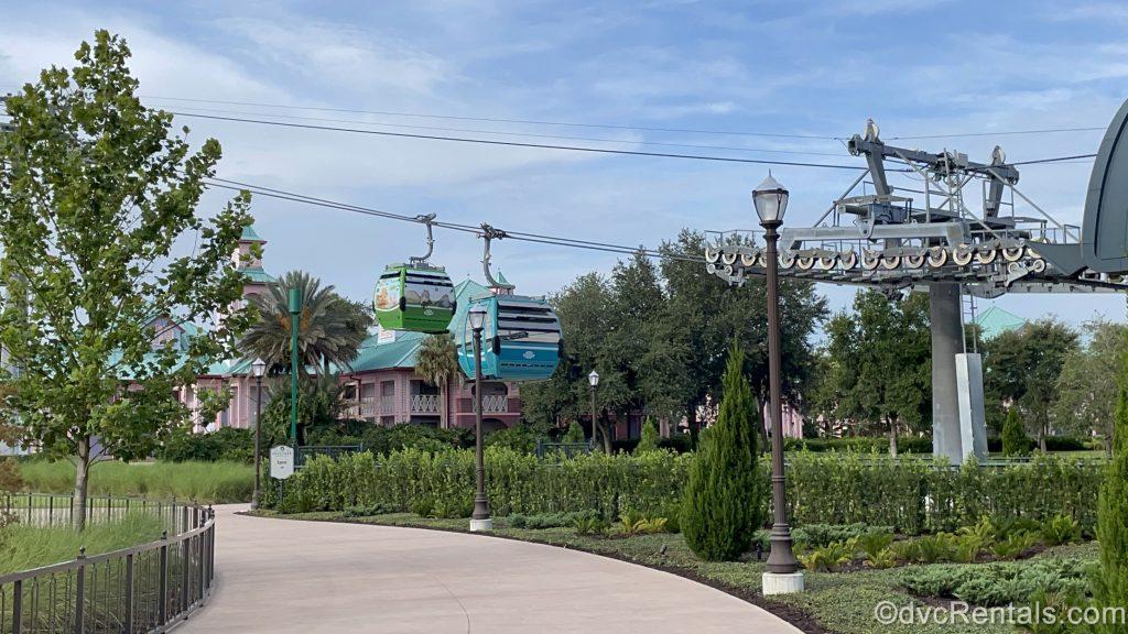 Skyliner gondolas leaving the Skyliner Station at Disney's Riviera Resort